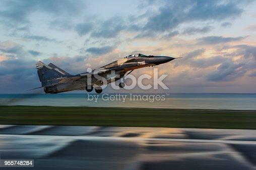 MiG 29 Fighter jet taking off at sunset