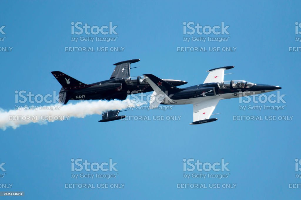 Fighter jets fly in formation during an air show stock photo