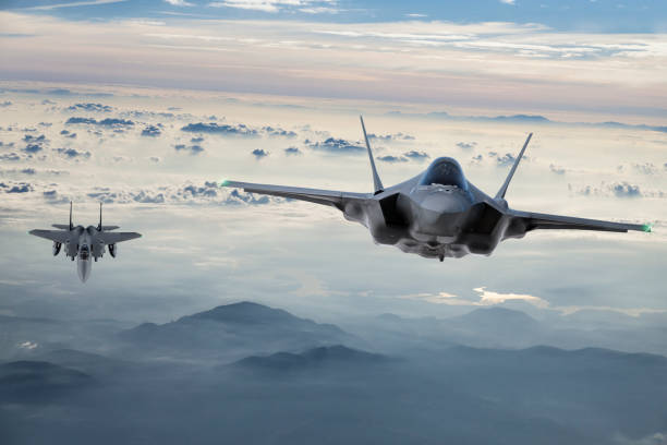 Fighter Jets flying at twilight stock photo