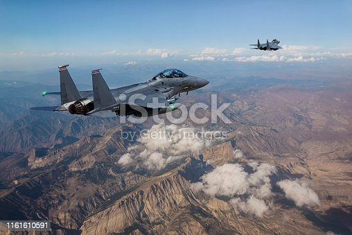F-15 Fighter Jets flying over mountains