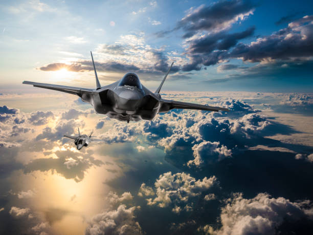 F-35 Fighter Jets flying over the clouds at sunset F-35 Fighter Jets flying over the clouds at sunset air force stock pictures, royalty-free photos & images