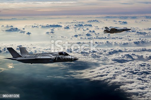 1145066973 istock photo Fighter Jets flying over the misty mountains at dusk 960481026