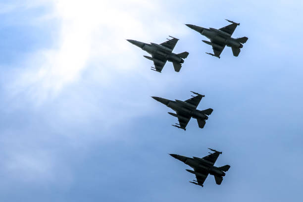 Fighter Jets in Formation Fighter Jets in Formation arrangement stock pictures, royalty-free photos & images