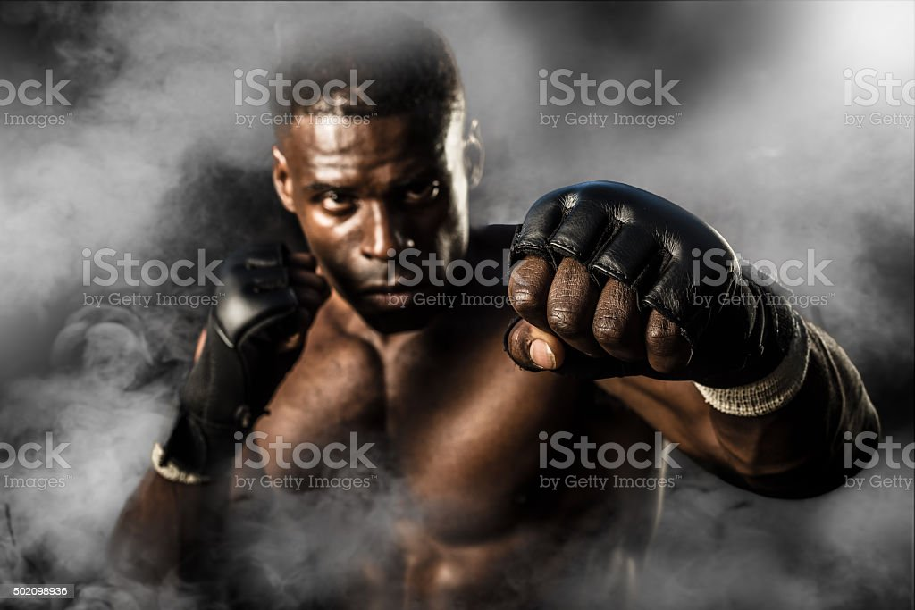 MMA Fighter On A Smokey  Background stock photo