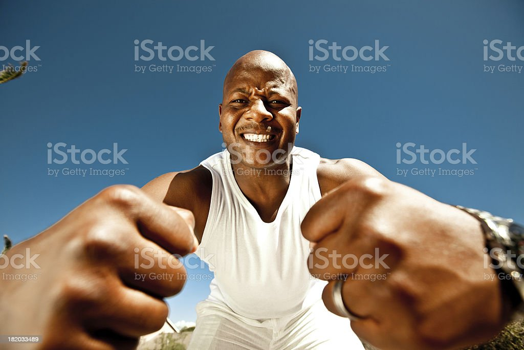 Fighter Angry man showing his fists at the camera. Adult Stock Photo