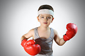 Super cute young boy with boxer gloves