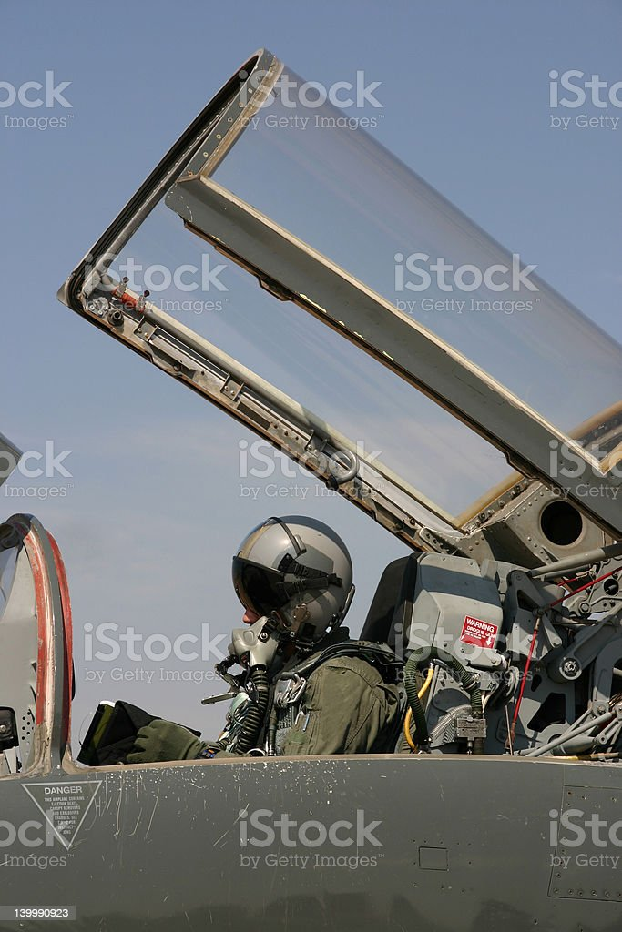 Fighter pilot getting ready to fly stock photo