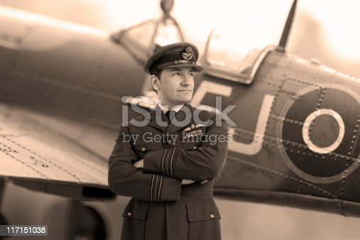 WWII Pilot in Squadron Leader Officers Uniform standing in front of a Spitfire Aircraft