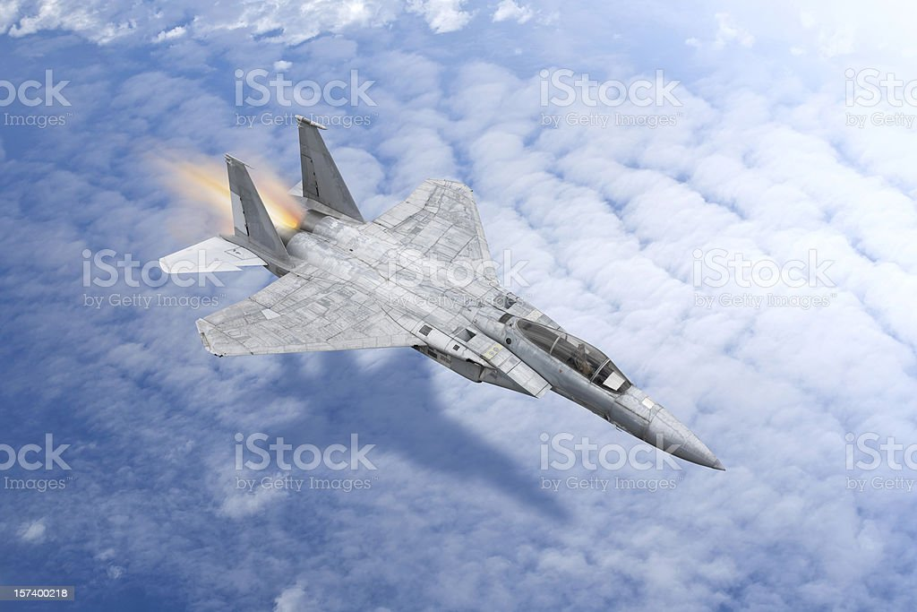 Fighter plane over the clouds royalty-free stock photo