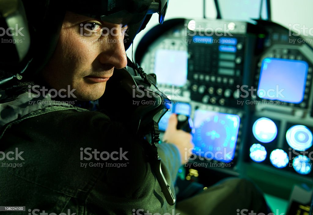 Fighter Plane Pilot Holding Throttle and Sitting Cockpit stock photo