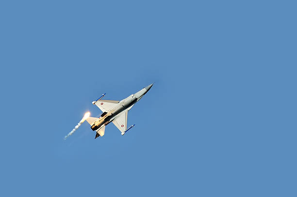 f16 fighter plane releasing infrared countermeasure decoy - number 16 stock photos and pictures