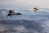 Fighter Jets flying over fogy mountains