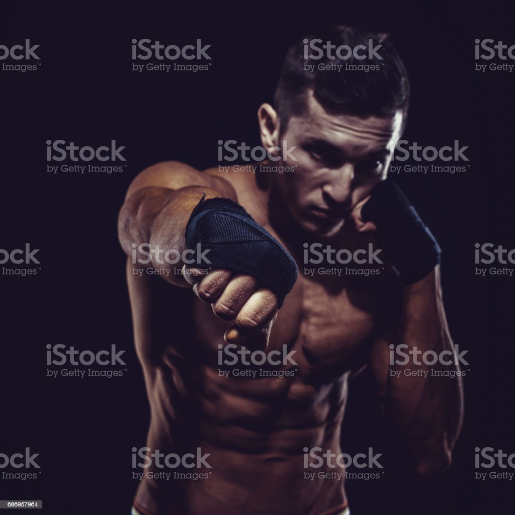 MMA Fighter Preparing Bandages For Training. Dark background – Foto
