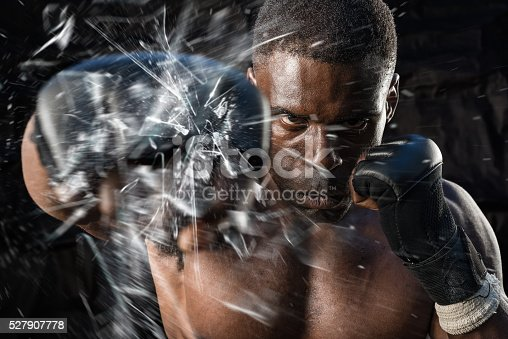 istock Fighter Punching Close Up Glass Shattering 527907778