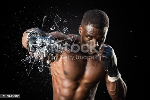 istock Fighter Punching Close Up Glass Shattering 527908352