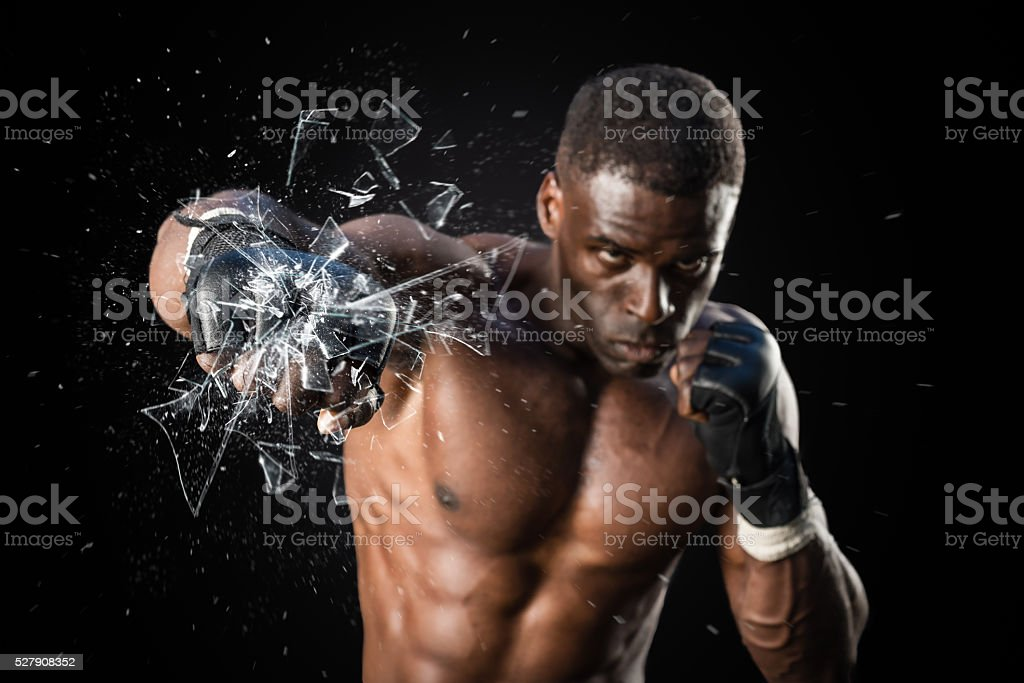 Fighter Punching Close Up Glass Shattering stock photo