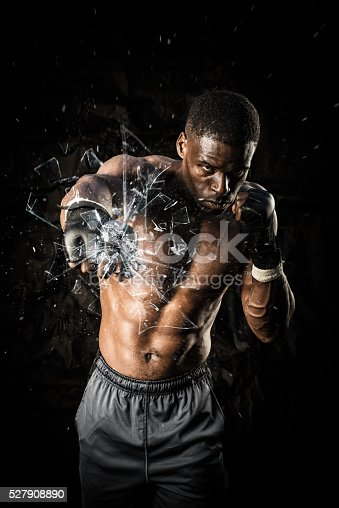 istock Fighter Punching Close Up Glass Shattering 527908890