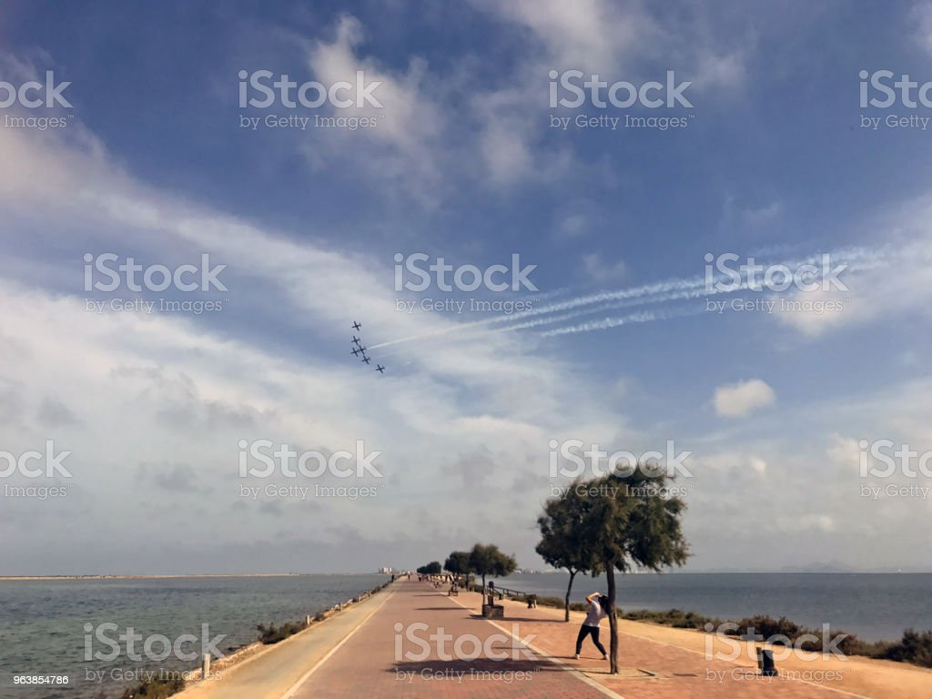 Fighter squadron in formation over seascape - Royalty-free Bay of Water Stock Photo
