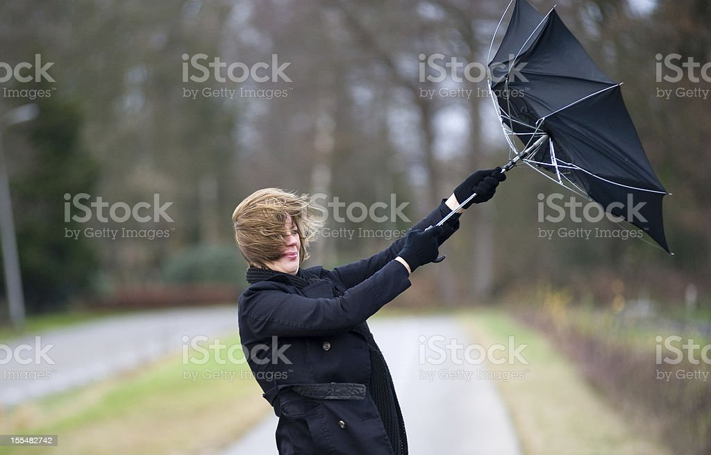 Fighting against the wind stock photo