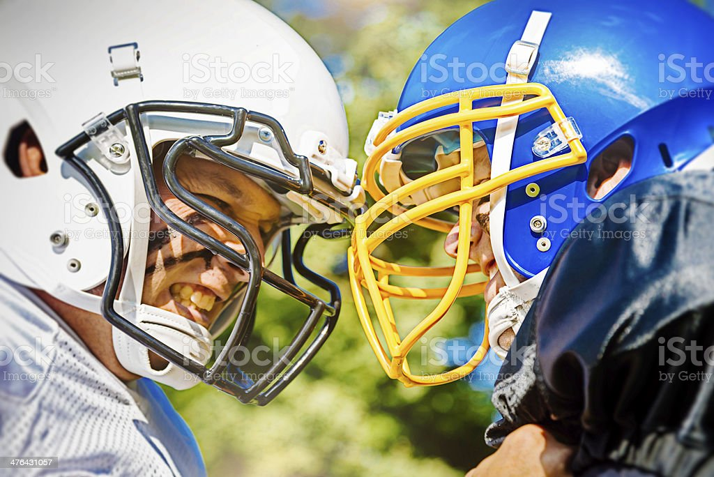 Fighting American Football Players royalty-free stock photo