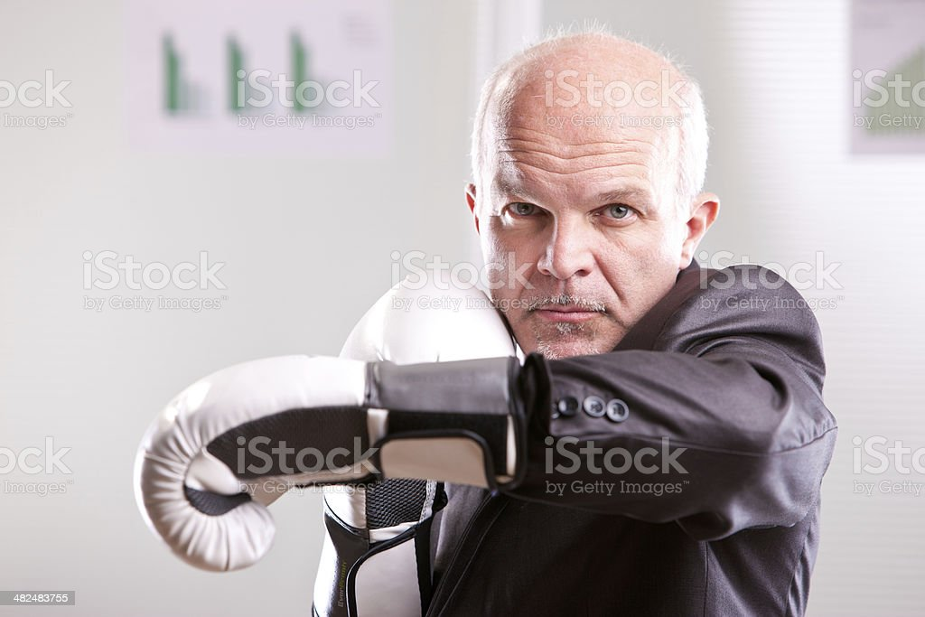 fighting business man upright and ready stock photo