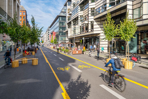 Pop-up bicycle lane in central Berlin with people biking, walking and relaxing. This is a trial concept for urban planning which improves the quality of life of people.