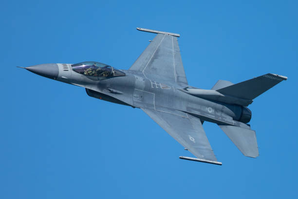 F-16 Fighting Falcon approaching at a very unusual close view F-16 Fighting Falcon approaching at a very unusual close view fighter plane stock pictures, royalty-free photos & images