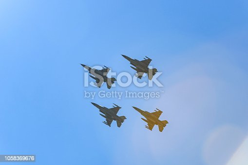 F-16 Fighting Falcon jets flying in formation in mid-air from their training grounds on the island of Vlieland to the Leeuwarden airbase.