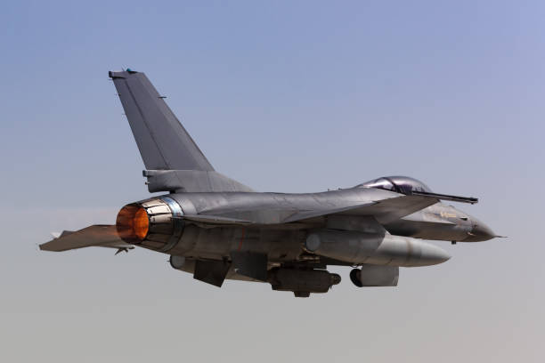 F-16 Fighting Falcon Takeoff Close view of an F-16 Fighting Falcon Taking off with afterburner f 16 fighting falcon stock pictures, royalty-free photos & images