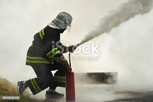 istock fighting fire during training 685908036