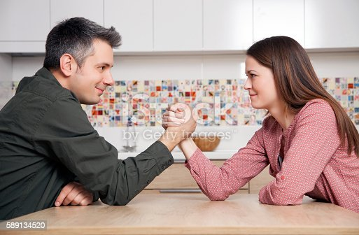 Young couple fighting for relationship domination