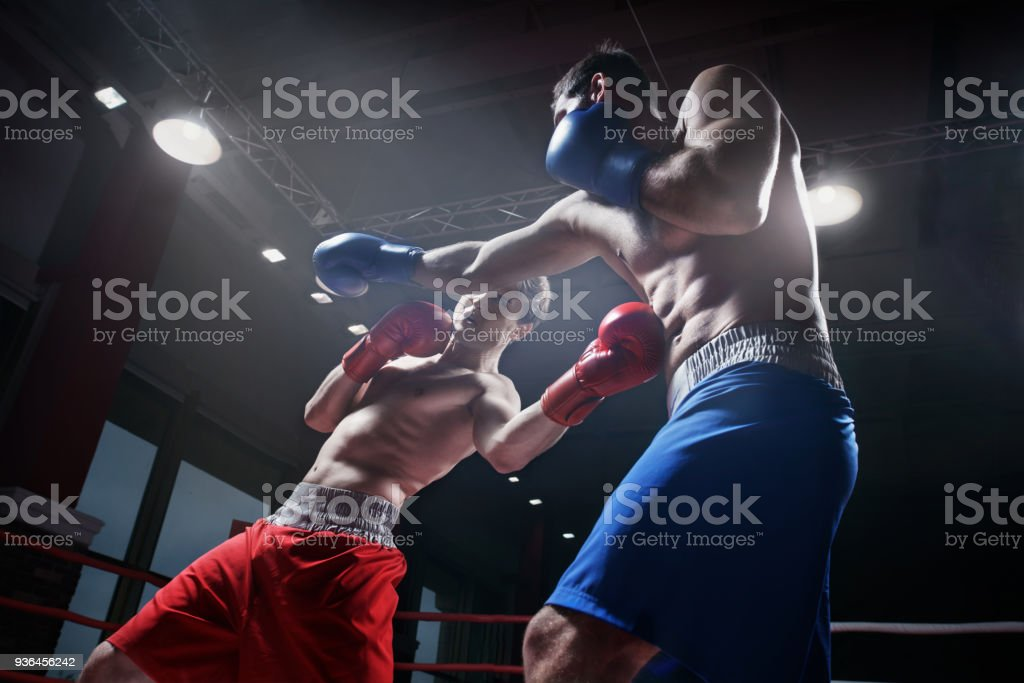 Fighting in boxing ring stock photo