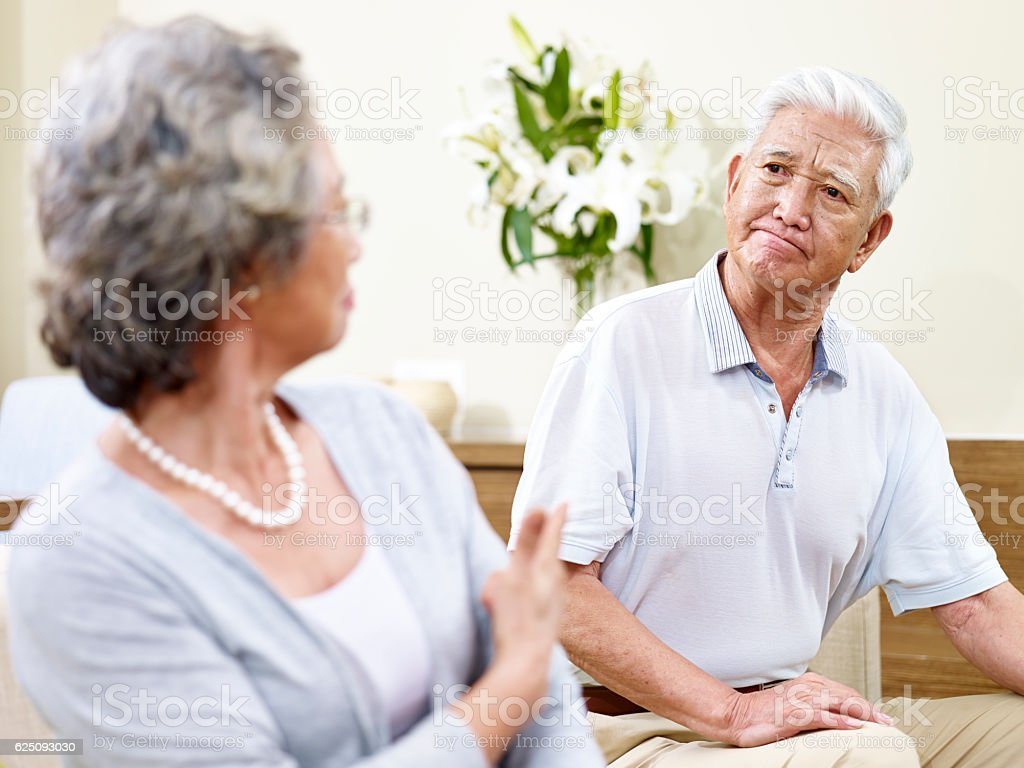 fighting senior asian couple stock photo