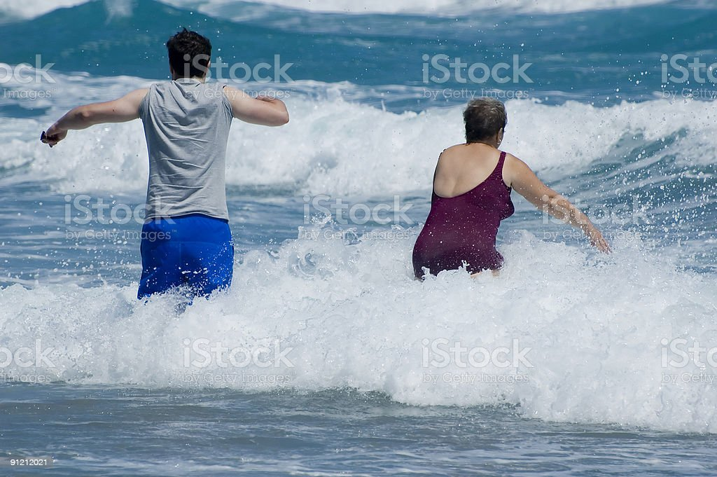 fighting the waves stock photo