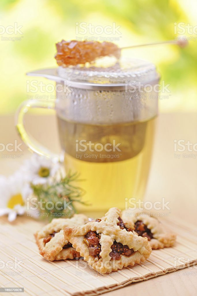 Fig-raisin creme cookie and hot tea royalty-free stock photo