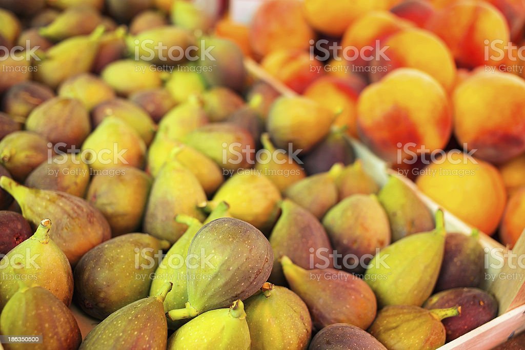 Figs and peaches at the market place royalty-free stock photo