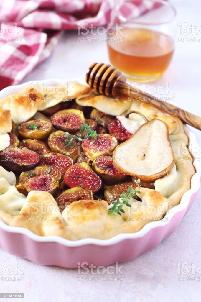 Figs and pears tart stock photo