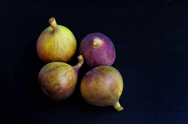 Figs on a black slate background stock photo