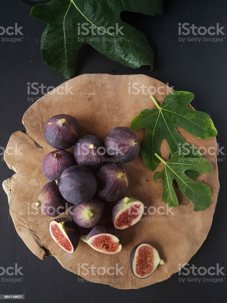 Figs on a wooden plate royalty-free stock photo