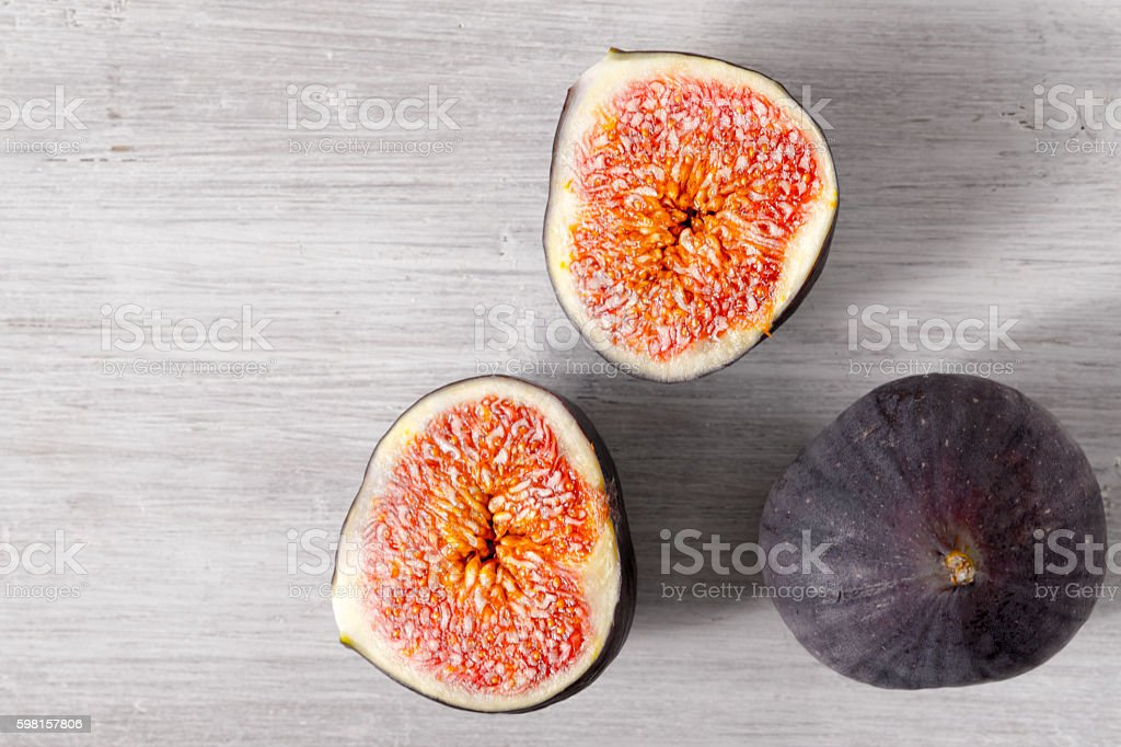 Figs on the white wooden table top view stock photo