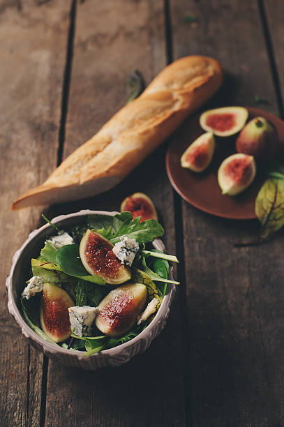 figs salad with blue cheese and ruccola on wooden background - fig salad imagens e fotografias de stock