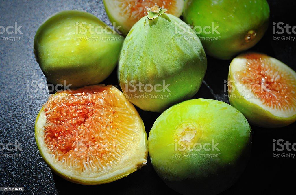 Figs sliced fruit on black background royalty-free stock photo