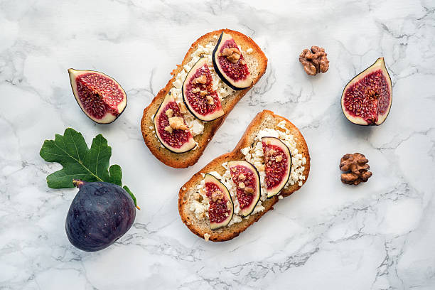Figs toast on marble. Top view. stock photo