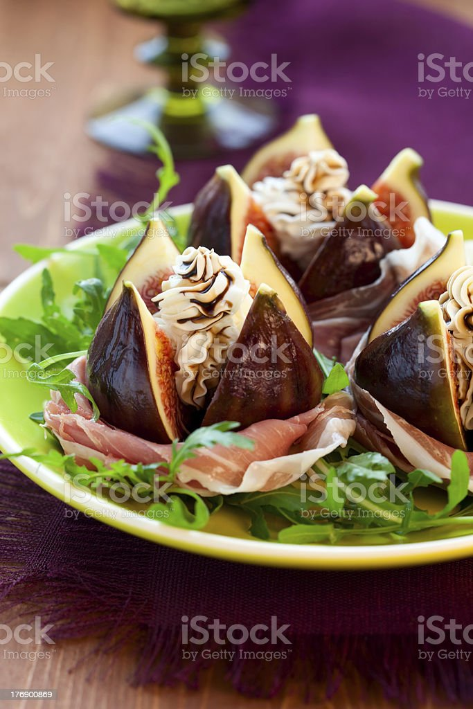 Figs with prosciutto,cheese and balsamic vinegar royalty-free stock photo