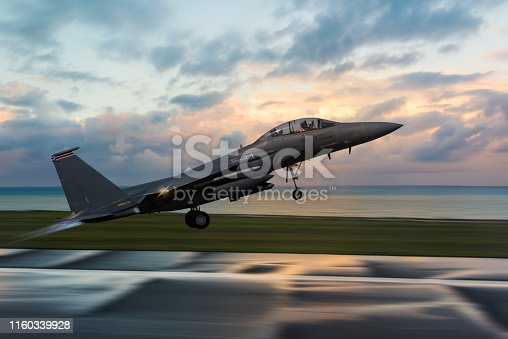 F-15 Figter Jet taking off at sunset