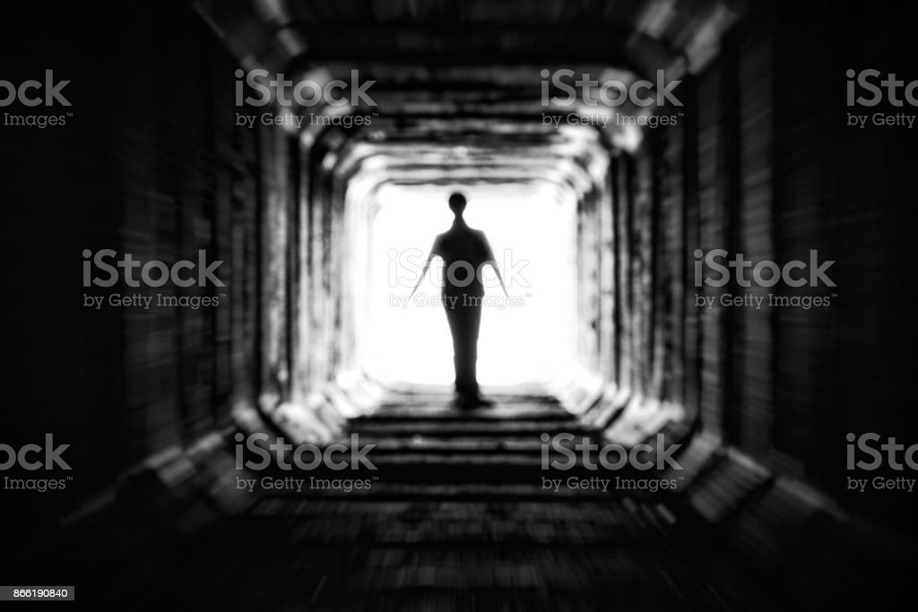 Figure at the end of the tunnel stock photo
