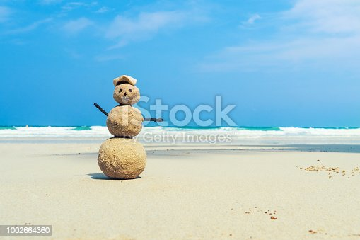 figure from sand on the seaside. trip, voyage, travellingbrit, traveling, travel, trek adventure cruise wandering progress. concept of a Maritime tour in a warm exotic country in the winter.