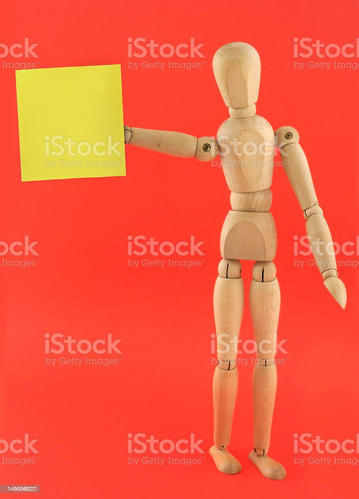 figure holding empty adhesive note royalty-free stock photo