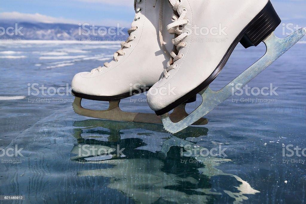 Figure ice skates at transparent ice. Winter outdoors sport concept photo libre de droits