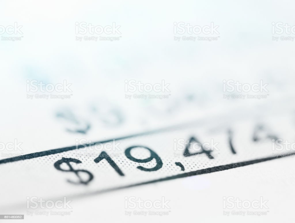 Figure in dollars at foot of a defocused spreadsheet stock photo